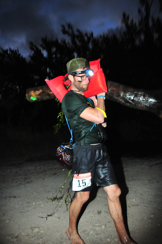 Carrying my log out of the water after the swim.